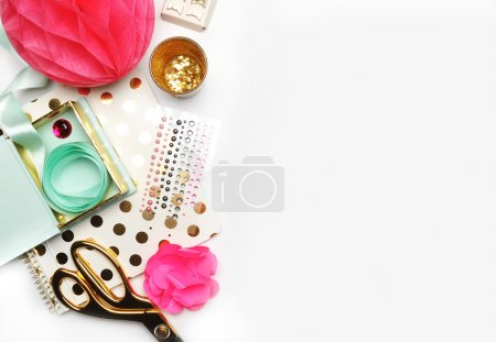 Flat lay, gold stationery on white table, notebook and stapler, woman style, desktop modern. Background mock-up. Glamour style, workspace. Wedding background. Gold polka dots.