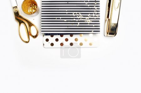 Woman Desktop. Header website or Hero website, Mockup product view table gold accessories. stationery supplies. glamour style. Gold stapler.