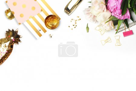 Flat lay. Flower on the table.  Gold pineapple, brush pattern and gold polka dots pattern. Table view. Business accessories. Mock-up background. Peonies, glamour style.