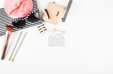 Glamour background, gloss female board, modern.Table view office items, white background mock up, woman desk. Flat lay.