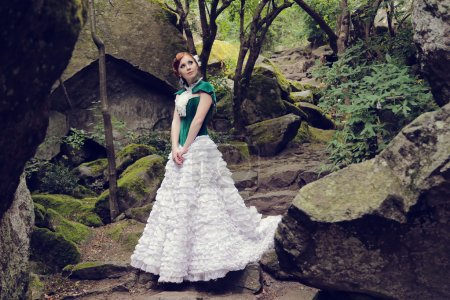 A woman like a princess in an vintage dress in fairy park
