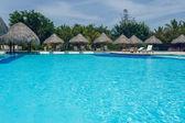 """Постер, картина, фотообои """"Бассейн открытый курорт роскошного отеля в спа-салоне летом на берегу моря. Тропический рай. Доминиканская Республика, Сейшелы, Карибский, Багамские острова."""""""