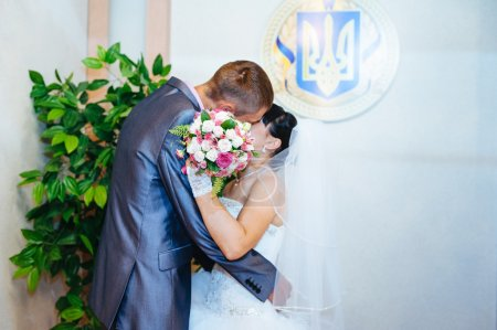 Photo for Wedding ceremony. Registry office. A newly-married couple signs the marriage document.Young couple signing wedding documents - Royalty Free Image