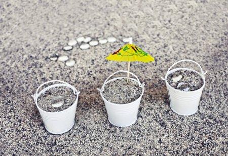 Little white buckets full of sand