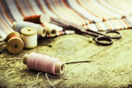 Old sewing tools  on table