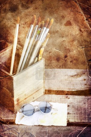 Background with white paper, sunglasses and brushes