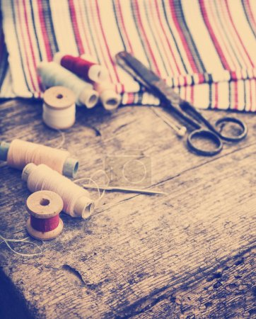 Scissors, fabric and bobbins with threads