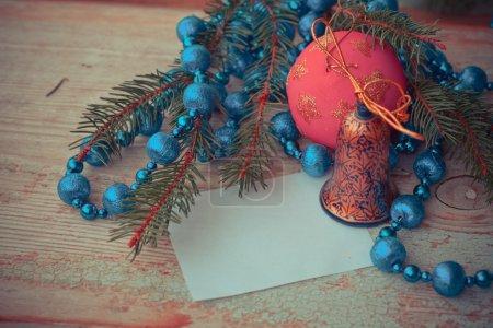Blue silver ornaments, fir branch, ball and bell
