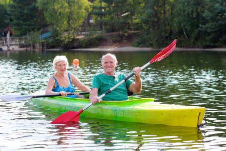 Seniors kayaking on the river