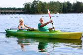 Seniors kayaking on the river