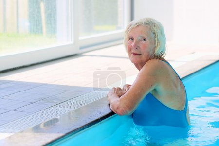 Healthy senior woman in swimming pool