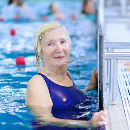 Active senior woman swimming in the pool