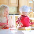 Happy family, grandmother with her granddaughter, ...
