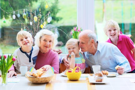 Grandparents with grandchildren enjoying Easter breakfast
