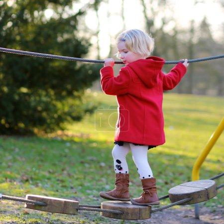 Preschooler girl having fun at playground