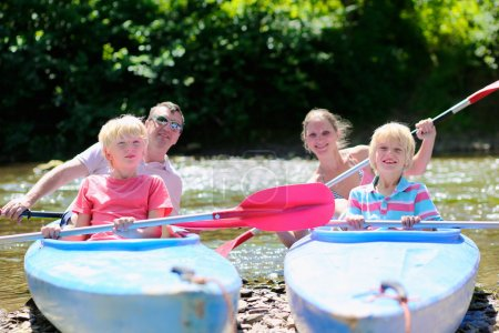 Happy family kayaking on the river