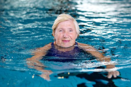 Active senior woman in swimming pool