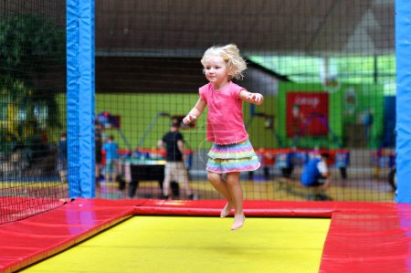 child jumping at trampoline