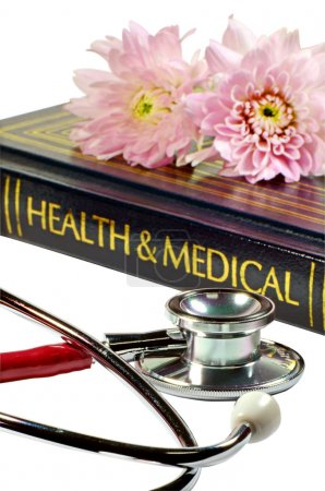 Stethoscope and medical text book isolated on whit...