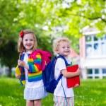 Постер, плакат: Kids on first school day