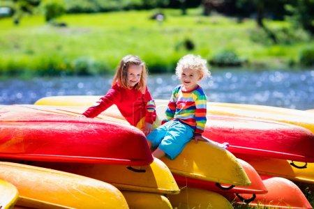 Two kids on piles of kayak