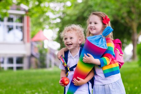 Kids with candy cone on first school day in Germany