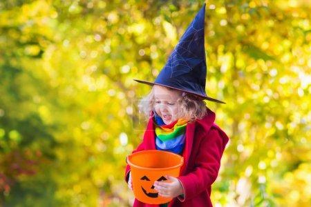 Little girl on Halloween trick or treat