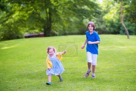 Happy kids running in a park