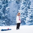 Постер, плакат: Happy child playing in snow