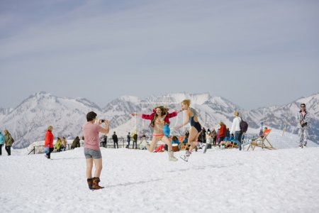 SOCHI, RUSSIA-APRIL 2016: skiers in swimsuits jumping in front of camera