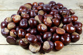 Fresh Chestnuts from an Autumn Harvest on an Old Wooden Table