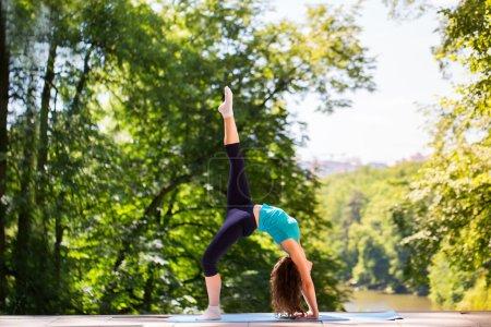 Fitness. Girl doing exercises in the park....