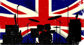 Grunge Union Jack flag as a background to a rock band silhouette