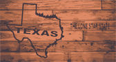Texas state map brand on wooden boards with map outline and state motto