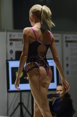 Photo for Moscow Traffic 5th International Exhibition of underwear, beachwear, home wear and hosiery Lingrie Expo Young blond woman in colored lingerie Motion - Royalty Free Image