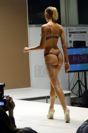 Photo for Moscow Traffic 5th International Exhibition of underwear, beachwear, home wear and hosiery Lingrie Expo Young beautiful blonde woman in color Swimwear - Royalty Free Image