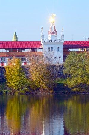 The Kremlin in Izmailovo Moscow Solar flare on the steeple Blue sky Autumn