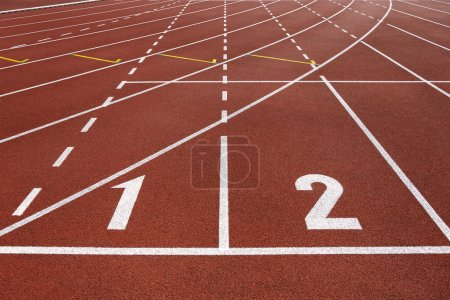 Photo for White numbers on a red running track. Vertical orientation. Success and competition concept - Royalty Free Image