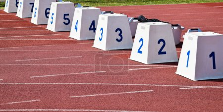Photo for Starting blocks on the running track - Royalty Free Image