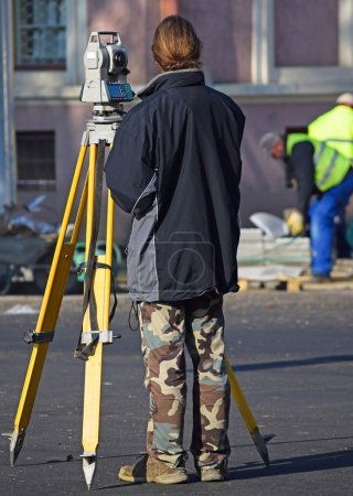 Land surveyor at the road construction