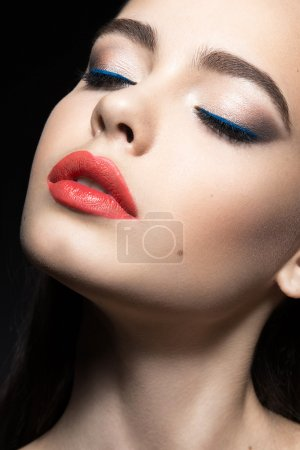 Beautiful woman with evening make-up, red lips. Beauty face.