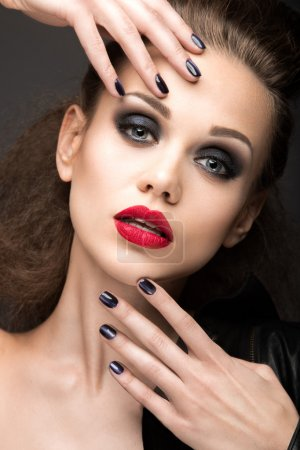 "Beautiful girl in leather jacket with bright makeup and manicure ""Cat's Eye"". Beauty face. Nail Design."