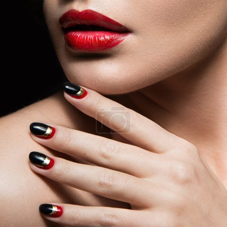 Beautiful girl with  black and red nails. Design manicure. Beauty face.