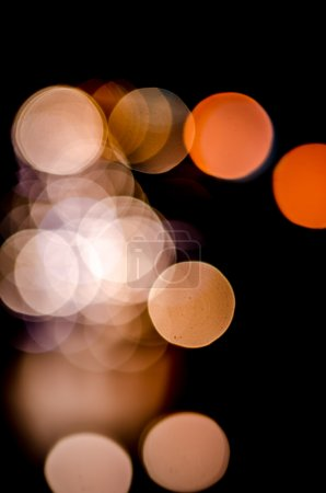 Colorful defocused bokeh lights background. Festive background w