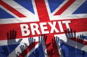 Két személy tartja kezében a hozzá matricát a zászló az Európai Közösség és az Egyesült Királyság lobogója mintás