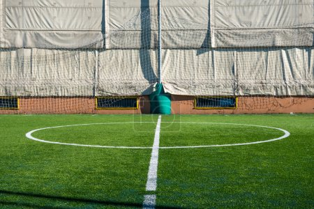 Photo for Photo of a green synthetic grass sports field with white line - Royalty Free Image