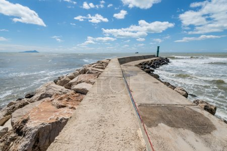 Breakwater at summer seashore