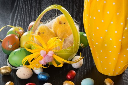 Toy chicks and chocolate easter eggs