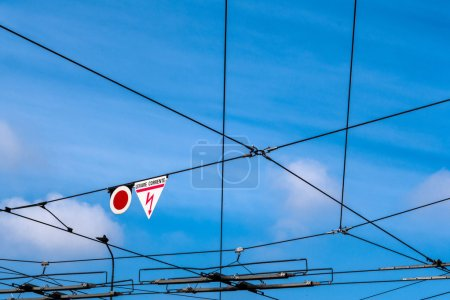 wires on sky  background with signs