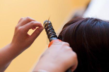 hands of  hairdresser who works